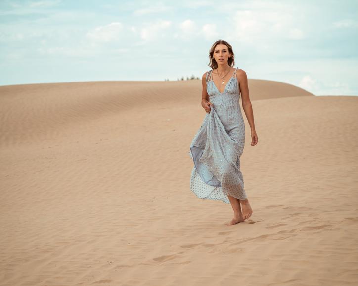 Vittoria in a blue dress.
